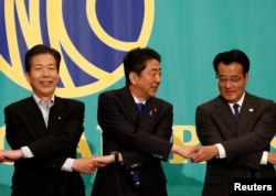 Japan's Prime Minister and leader of the ruling Liberal Democratic Party (LDP) Shinzo Abe (C), the leader of the Democratic Party Katsuya Okada (R) and Komeito party leader, Natsuo Yamaguchi, attend a debate with rival party leaders ahead of July 10 upper house election in Tokyo, June 21, 2016.