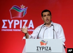 FILE - Greek Prime Minister Alexis Tsipras addresses a meeting of his ruling radical left Syriza party's central committee in Athens, July 30, 2015.