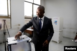 FILE - Emmanuel Ramazani Shadary, former Congolese Interior minister and presidential candidate, casts his vote at a polling station in Kinshasa, Democratic Republic of Congo, Dec. 30, 2018.