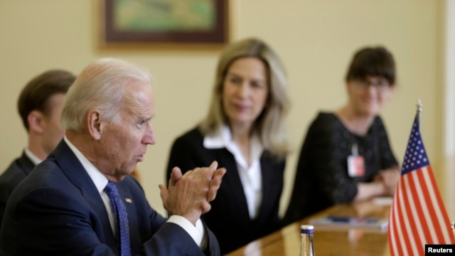 U.S. Vice President Joe Biden (L) speaks during meeting with Latvia's President Andris Berzins (not pictured) in Vilnius March 19, 2014.