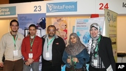 Adel Youssef (middle) and the team behind the IntaFeen application, Cairo, Egypt, March 20, 2012.