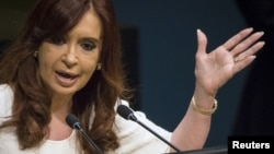 FILE - President of Argentina Cristina Fernandez de Kirchner addresses attendees during the 70th session of the United Nations General Assembly at the U.N. headquarters in New York, Sept. 28, 2015.
