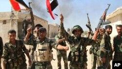 Sojojin Syria suna bikin sake kwato Achandake yankin Hama cikin Syria.