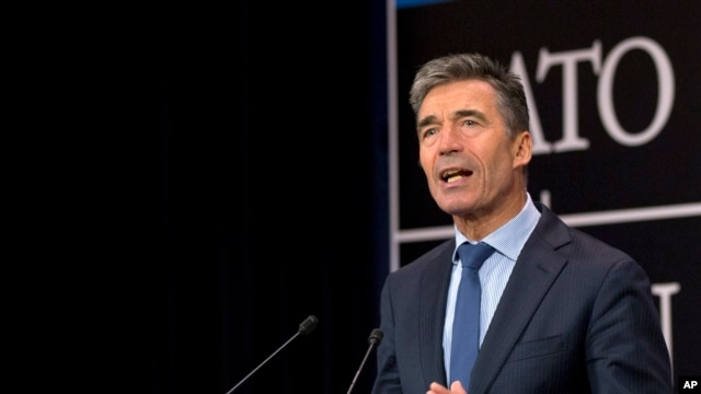 NATO Secretary General Anders Fogh Rasmussen speaks during a media conference at NATO headquarters in Brussels, June 25, 2014.