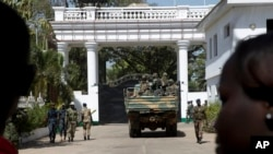 Senegalese troops enter the State House in Banjul, Gambia, Jan. 23, 2017, two days after Gambia's defeated leader Yahya Jammeh left the country.