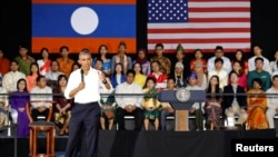Participants listen as U.S. President Barack Obama holds a town hall-style meeting with a group of Young Southeast Asian Leaders Initiative (YSEALI) attendees, alongside his participation in the ASEAN Summit, at Souphanouvong University in Luang Prabang,