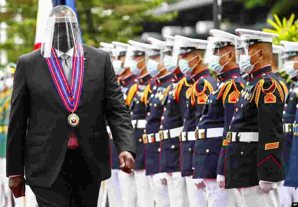 United States Defense Secretary Lloyd Austin views the military honor guard at Camp Aguinaldo military camp in Quezon City, Metro Manila, Philippines.