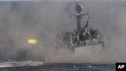 FILE- A South Korean navy patrol boat fires during an exercise off South Korea's southeastern coast near Busan, South Korea.