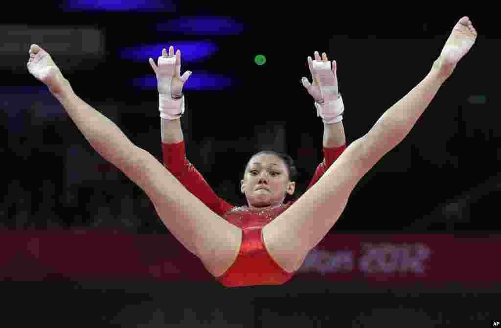 U.S. gymnast Kyla Ross performs on the uneven bars during the Artistic Gymnastics women's team final at the 2012 Summer Olympics, July 31, 2012, in London.