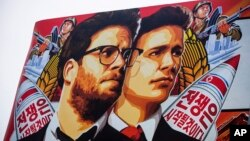 "FILE - A banner for the film ""The Interview"" by Sony Pictures is posted outside a theater in Hollywood, California, December 2014."