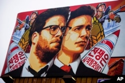 "A banner for ""The Interview,"" a firm whose release has been delayed by Sony Pictures, is posted outside Arclight Cinemas in Hollywood, California, Dec. 17, 2014"