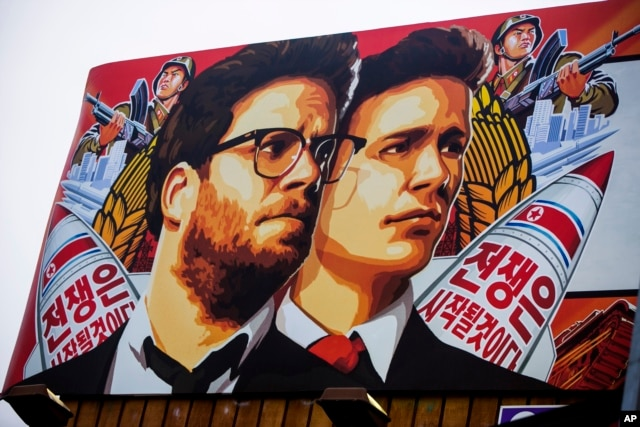 """A banner for """"The Interview,"""" a firm whose release has been delayed by Sony Pictures, is posted outside Arclight Cinemas in Hollywood, California, Dec. 17, 2014"""