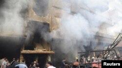 Posledice eksplozije bombe postavljene u jednom automobilu, u Damasku
