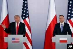 FILE - U.S. President Donald Trump, left, speaks during a news conference with Polish President Andrzej Duda at Royal Castle in Warsaw, July 6, 2017.