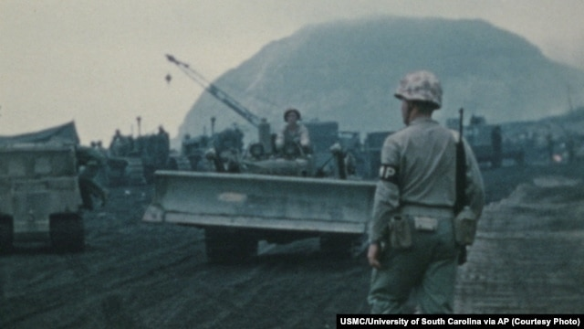 This scene from the Battle of Iwo Jima, recorded by the U.S. Marine Corps in 1945, is part of a collection of silent color films being preserved at the University of South Carolina in Columbia, S.C.