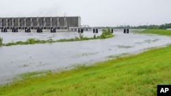 FILE - This Saturday, July 13, 2019, file photo shows the Gulf Intracoastal Waterway West Closure Complex, in Belle Chasse, La.