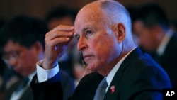 California Gov. Jerry Brown attends the Clean Energy Ministerial International Forum on Electric Vehicle Pilot Cities and Industrial Development, at a hotel in Beijing, June 6, 2017.