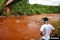 An Indigenous man from the Pataxo Ha-ha-hae tribe looks at Paraopeba river, after a tailings dam owned by Brazilian mining company Vale SA collapsed, in Sao Joaquim de Bicas near Brumadinho, Brazil, Jan. 25, 2019.