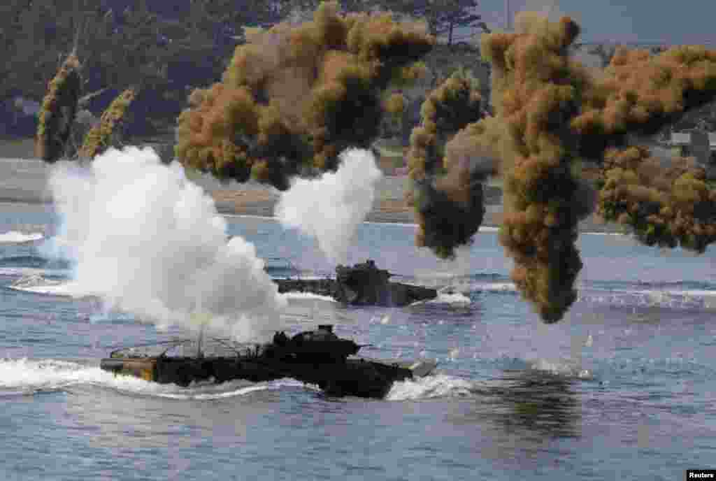 South Korean Marine Corps take part in a practice for a U.S.-South Korea joint landing operation drill in Pohang, about 370 km (230 miles) southeast of Seoul.
