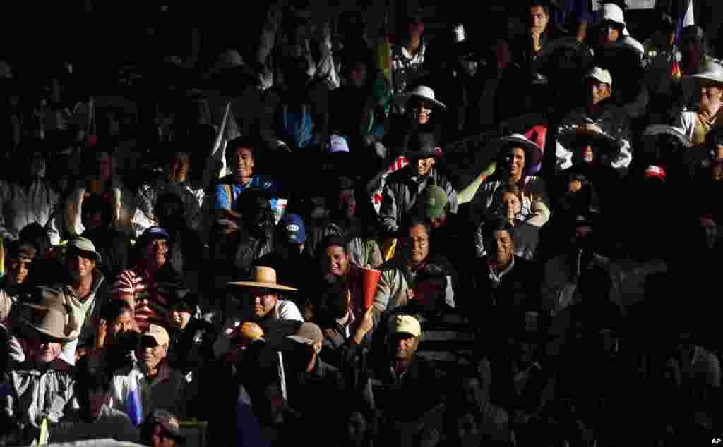 Supporters of Bolivia's President Evo Morales attend the welcoming ceremony for presidents in Cochabamba, Bolivia, July 4, 2013.