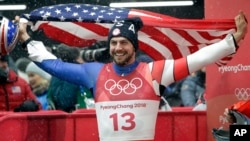 Chris Mazdzer of United States celebrates his silver medal win during final heats of the men's luge competition at the 2018 Winter Olympics in Pyeongchang, South Korea, Sunday, Feb. 11, 2018. (AP Photo/Wong Maye-E)