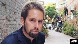 "This undated photo at an undisclosed location provided to AFP by the 'Chinese Urgent Action Working Group' shows Swedish human rights activist Peter Dahlin. Chinese state media on January 19 accused Peter Dahlin, detained amid a crackdown on outspoken lawyers, of inciting ""opposition to the government"", publishing a ""confession"" from a detained colleague."