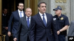 FILE - President Donald Trump's personal attorney Michael Cohen (R) and his attorney Stephen Ryan (2nd-L) leave Federal Court, in New York, May 30, 2018.