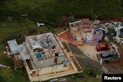The contents of a damaged home can be seen as recovery efforts continue following Hurricane Maria near the town of Comerio, Puerto Rico, October 7, 2017.