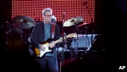 """FILE - Eric Clapton, center, performs during his """"70th Birthday Celebration"""" concert at Madison Square Garden on Friday, May 1, 2015, in New York."""