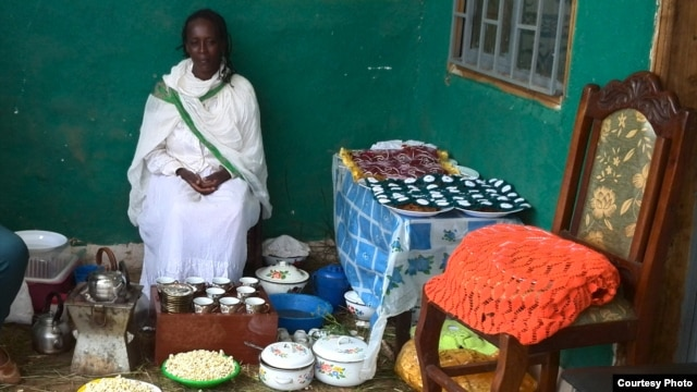 The front porch is the setting for coffee ceremonies where women of Dosha discuss new health practices for the neighborhood (VOA/Joana Mantey)
