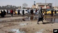 Lapangan Adan di Ibu Kota Irak, Baghdad setelah serangan bom bunuh diri, 9 Februari 2015. Serangan bom bunuh diri terjadi kembali di Lapangan Adan, Sabtu, 13 Januari 2018.