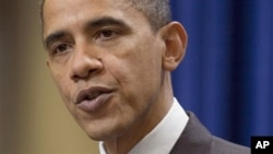President Barack Obama pauses during a statement about the US-Korea Free Trade Agreement on in Washington, 04 Dec 2010