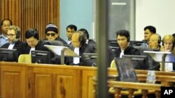 """Brother Number Two"" Nuon Chea (4th L) and former Khmer Rouge foreign minister Ieng Sary (2nd R) sit at the Extraordinary Chambers in the Courts of Cambodia (ECCC) on the outskirts of Phnom Penh, file photo."