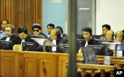 """""""Brother Number Two"""" Nuon Chea (4th L) and former Khmer Rouge foreign minister Ieng Sary (2nd R) sit at the Extraordinary Chambers in the Courts of Cambodia (ECCC) on the outskirts of Phnom Penh June 29, 2011."""