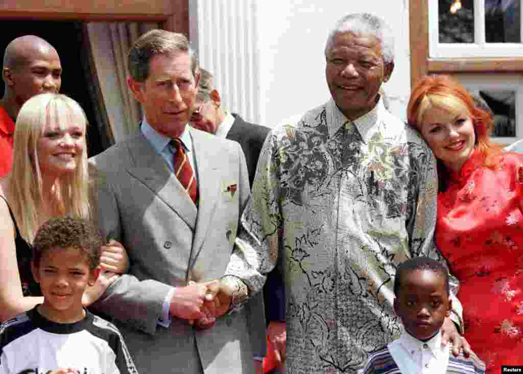 President Nelson Mandela and Britain's Prince Charles shake hands alongside members of the Spice Girls' Emma (L), and Gerri (R) at Mr. Mandela's residence November 1, 1997.