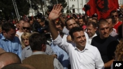 Zoran Zaev, center, the leader of the opposition Social Democrats, waves to the supporters during a protest in Skopje, Macedonia, May 17, 2015.