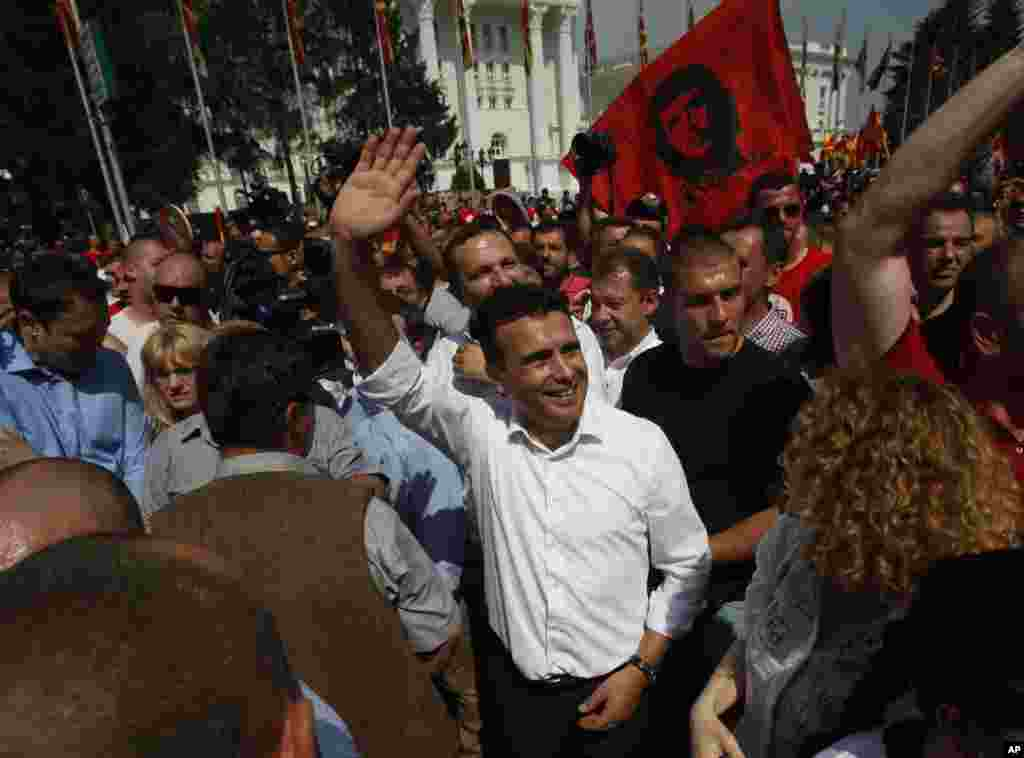 Zoran Zaev, center, the leader of the opposition social democrats, waves to the supporters during a protest in front of the Government building in Skopje, May 17, 2015.