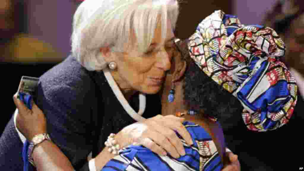 IMF Managing Director Christine Lagarde, left, greets, Ngozi Okonjo-Iweala, Finance Minister of Nigeria, before a meeting of the G-24, during the Spring Meetings of the World Bank Group and the International Monetary Fund.