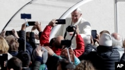Pope Francis arrives in St.Peter's Square for his weekly general audience, at the Vatican, Wednesday, March 21, 2018.