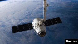 FILE - The SpaceX Dragon cargo capsule approaches the International Space Station prior to installation in this NASA picture taken April 10, 2016. The company recently completed the first re-flight of one of its capsules.
