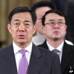 中共重庆市委书记薄熙来(左)和重庆市副市长王立军(右)(资料照)。