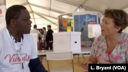 Congolese priest Mick Ngundu speaks to Veronique Couque in Caen, France. Their paths might never have crossed had it not been for Living Libraries.