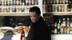 A man in front of a liquor store in Moscow last year