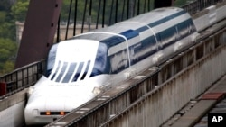 Japan's Magnetic Levitation, or linear motor car MLX01-901A, runs on a rest course of Yamanashi Experiment Center in Tsuru, Japan, Tuesday, May 11, 2010. (AP Photo/Itsuo Inouye)