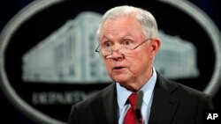 FILE - United States Attorney General Jeff Sessions speaks during a news conference at the Justice Department in Washington.