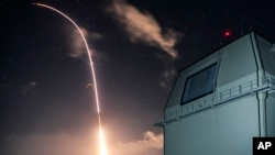 Photo provided by the U.S. Missile Defense Agency (MDA) shows the launch of the U.S. military's land-based Aegis missile defense testing system, that later intercepted an intermediate range ballistic missile, from the Pacific Missile Range Facility on the