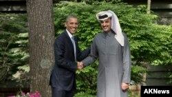 El presidente Obama saluda al emir de Qatar Sheik Tamim bin Hamad Al-Thani, tras reunirse en Camp David, el 14 de mayo, de 2015.