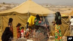 A displaced family at Al Mazrak camp in northern Yemen