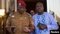 Lieutenant Colonel Yacouba Isaac Zida (L) meets with opposition leader Zephirin Diabre in Ouagadougou, capital of Burkina Faso, Nov. 2, 2014.