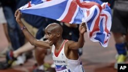 Britain's Mo Farah celebrates winning gold in the men's 10,000-meter final during the athletics in the Olympic Stadium at the 2012 Summer Olympics, London, August 4, 2012.